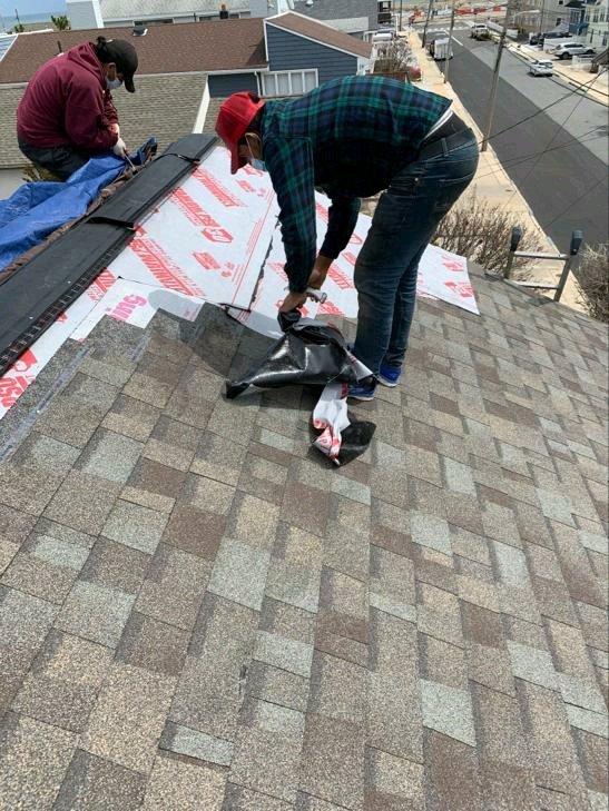 New roof shingle installation